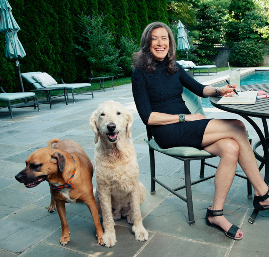 Amy Siskind with dogs by the pool